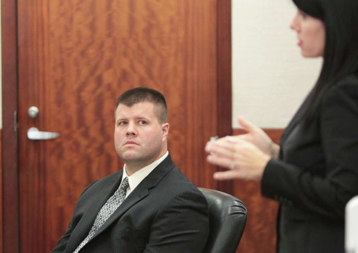 Ex-HPD officer Drew Ryser listens to his attorney, Lisa Andrews, object as the prosecution makes final arguments in his trial Tuesday. Ryser is the fourth and final HPD officer accused of wrongdoing in the 2010 videotaped beating of then-15-year-old Chad Holley.