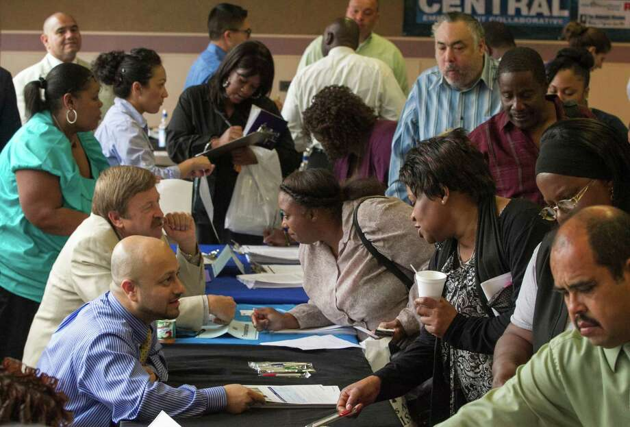 In this Thursday, June 6, 2013, photo, job seekers inquire for positions at the 12th annual Mission career fair in the skid raw area of Los Angeles. The government reports the latest Job Openings and Labor Turnover Survey on Tuesday, June 11, 2013. Photo: Damian Dovarganes