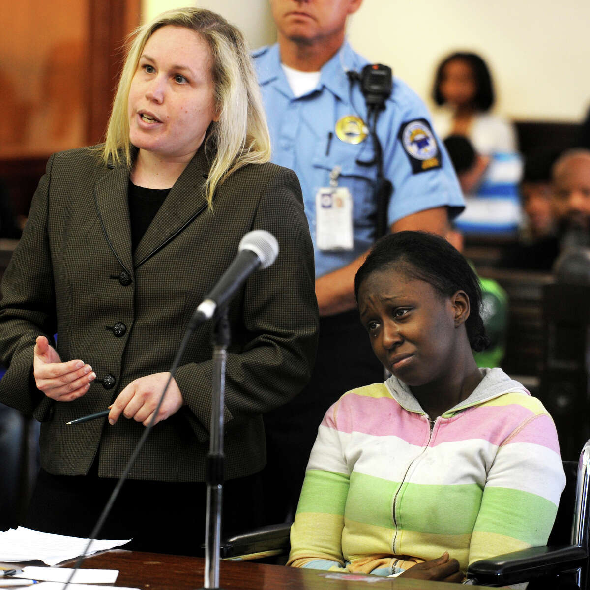 Cherelle Baldwin, right, is arraigned in Superior Court, in Bridgeport, Conn., June 11th, 2013. Baldwin has been charged with the murder of Jeffrey Brown, who, police say, died on May 18th after he was crushed against a garage's cinder-block wall by a car that Baldwin was driving. Baldwin is seen here with defense attorney Sam Kretzmer.