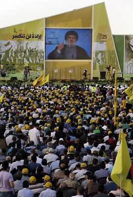 "Hezbollah leader Sheik Hassan Nasrallah speaks from an undisclosed location during a rally commemorating ""Liberation Day,"" which marks the withdrawal of the Israeli army from southern Lebanon in 2000, in Mashghara village, Bekaa valley, Lebanon, Saturday May 25, 2013. Nasrallah says his Shiite militant group will not stand idly by while its chief ally Syria is under attack. Nasrallah says Hezbollah members are fighting in Syria against Islamic extremists who pose a danger to Lebanon, publicly confirming for the first time that his men were fighting in Syria. (AP Photo/Hussein Malla)"