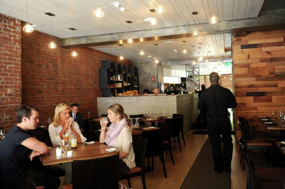 The interior has a warm feel of the Harvest Wine Bar & Restaurant at 372 Greenwich Ave., Greenwich, Conn., Wednesday, May 29, 2013. Photo: Helen Neafsey / Greenwich Time