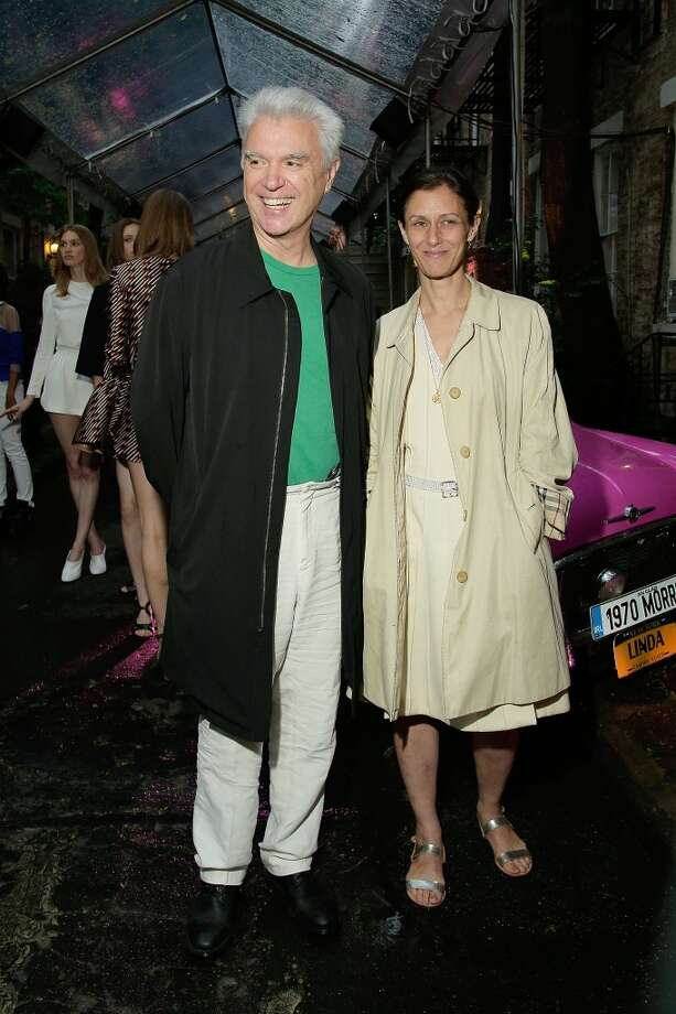 NEW YORK, NY - JUNE 10:  David Byrne and guest attend the Stella McCartney Spring 2014 Collection Presentation Street on June 10, 2013 in New York City.  (Photo by Randy Brooke/Getty Images)