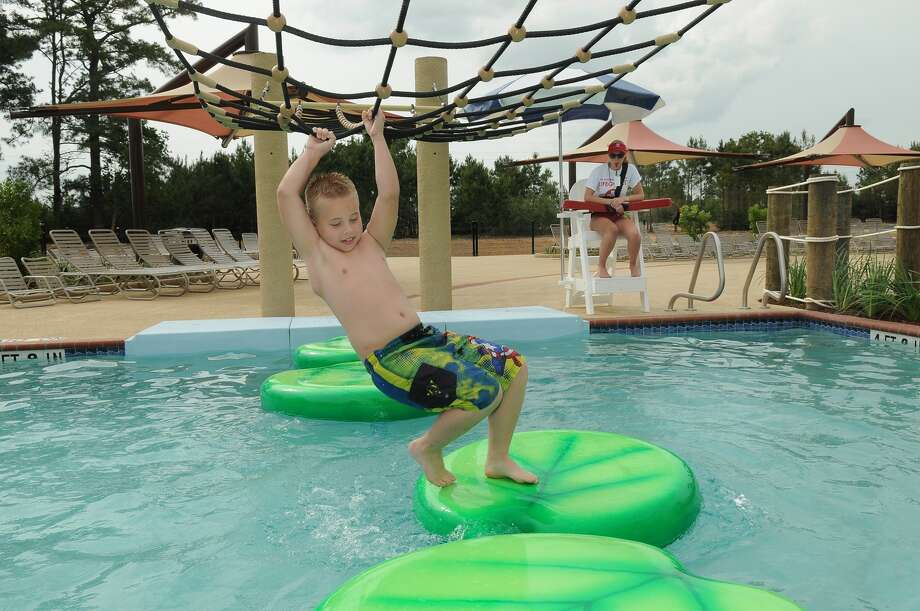New place to play opens in creekside park houston chronicle - Evergreen high school swimming pool ...