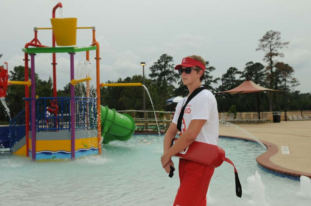 Lifeguard Matthew Pastusek 17 A Student At The Woodlands High School Walks