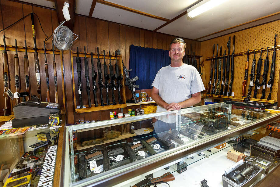 Helotes native and city fire department Capt. Jack Quipp stands behind the counter of his recently opened store, Helotes Tactical Firearms. Photo: Marvin Pfeiffer / Northwest Weekly
