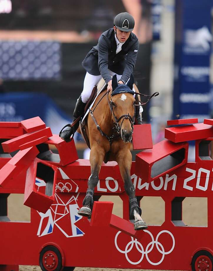 "Double decker now a single decker: Instead of going over it, Ursula XII, ridden by Scott Brash, smashes through the ""London bus"" obstacle during the Longines Global Champions Tour at Olympic Park in London. Photo: Mike Hewitt, Getty Images"