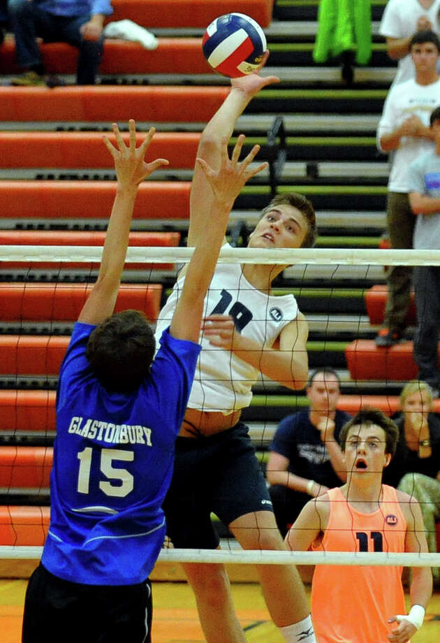 Staples' Lucas Grevers spikes the ball as Glastonbury's Skyler Schultz tries to block, during Class L volleyball finals action in Shelton, Conn. on Friday June 7, 2013. Photo: Christian Abraham / Connecticut Post
