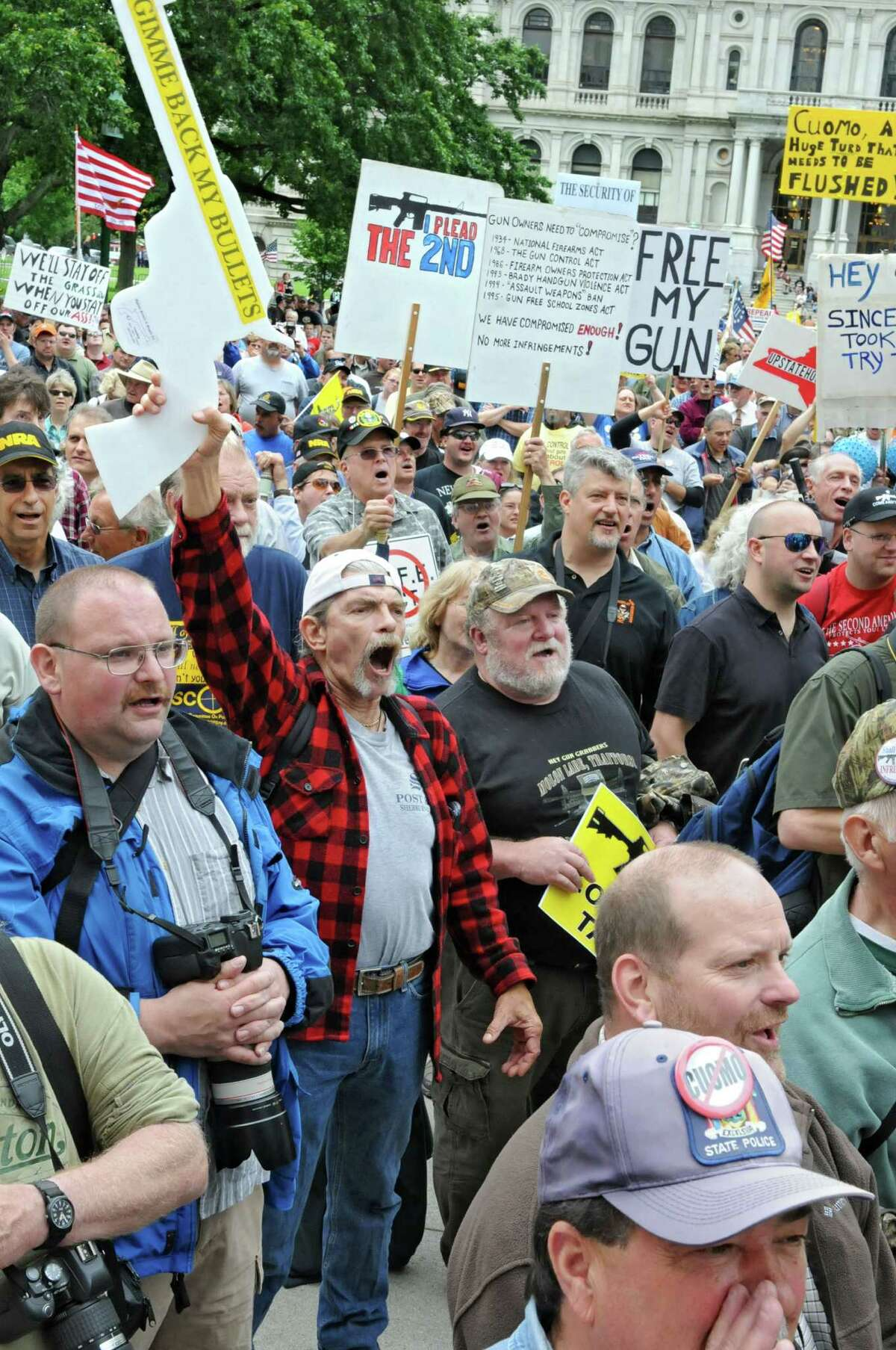 The crowd cheers during an anti-SAFE Act rally at the West Capitol Park on Tuesday, June 11, 2013 in Albany, N.Y. (Lori Van Buren / Times Union)