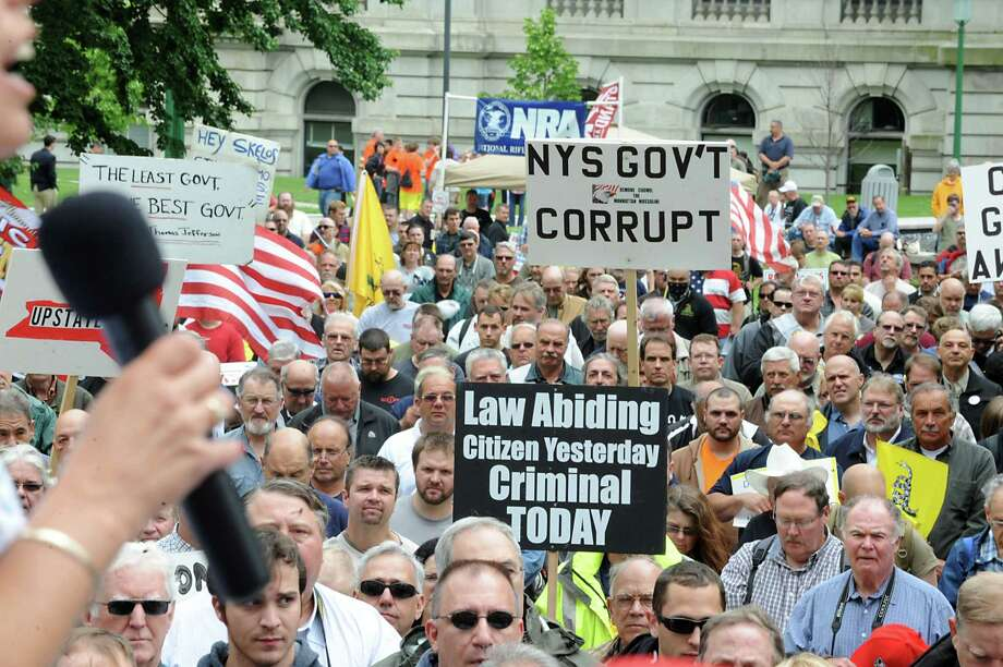 The crowd listens as radio host Melody Burns speaks during an anti-SAFE Act rally at the West Capitol Park on Tuesday, June 11, 2013 in Albany, N.Y.  (Lori Van Buren / Times Union) Photo: Lori Van Buren / 00022762A