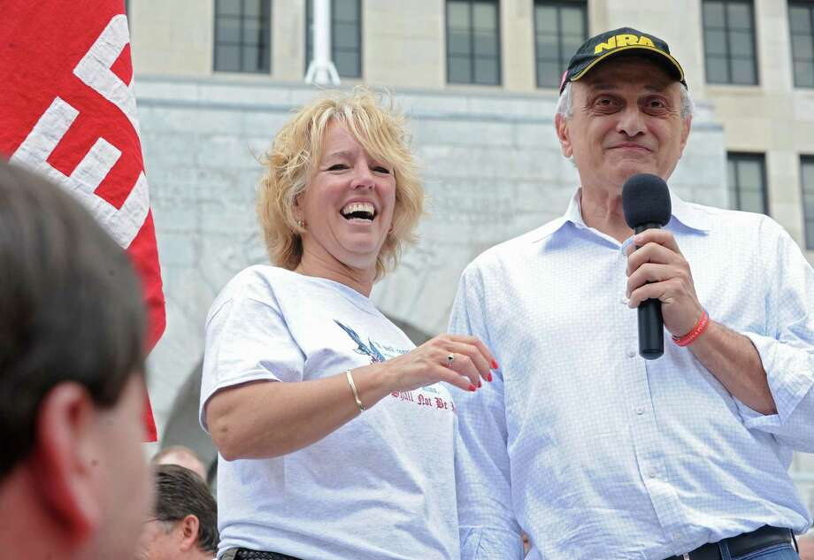 Radio host Melody Burns and fomer gubernatorial candidate Carl Paladino get ready to sing God Bless America during an anti-SAFE Act rally at the West Capitol Park on Tuesday, June 11, 2013 in Albany, N.Y.  (Lori Van Buren / Times Union) Photo: Lori Van Buren / 00022762A