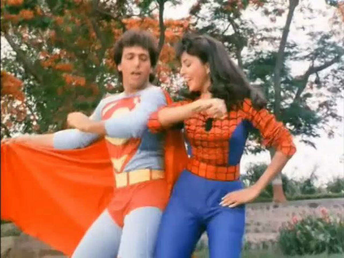 Superman and Spiderwoman displaying the power of dance in the Indian movie