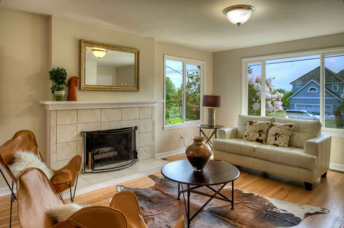 Living room of 5215 16th Ave. S.W. The 2,280-square-foot house, built in 1953, has five bedrooms and two bathrooms, including a basement apartment, and a big back deck on a 5,546-square-foot lot. It's listed for $449,000.