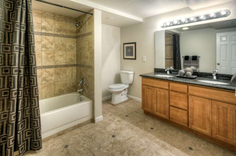 Basement bathroom of 5215 16th Ave. S.W. The 2,280-square-foot house, built in 1953, has five bedrooms, two bathrooms and a big back deck on a 5,546-square-foot lot. It's listed for $449,000. Photo: Suveen Vuppala, Professional Realty Services Of Washington