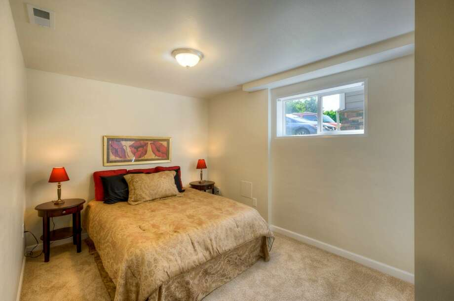 Basement bedroom of 5215 16th Ave. S.W. The 2,280-square-foot house, built in 1953, has five bedrooms, two bathrooms and a big back deck on a 5,546-square-foot lot. It's listed for $449,000. Photo: Suveen Vuppala, Professional Realty Services Of Washington
