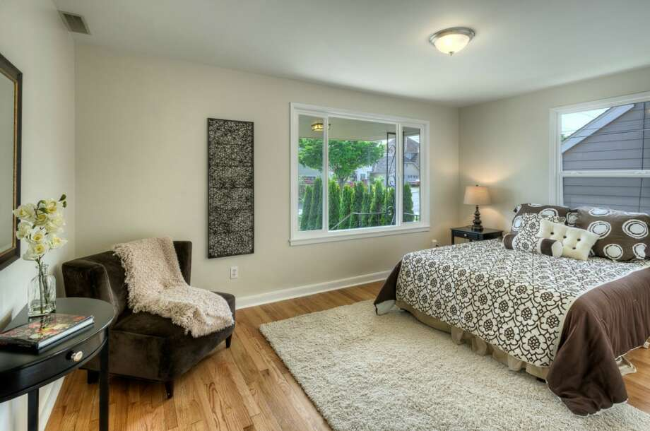 Bedroom of 5215 16th Ave. S.W. The 2,280-square-foot house, built in 1953, has five bedrooms and two bathrooms, including a basement apartment, and a big back deck on a 5,546-square-foot lot. It's listed for $449,000. Photo: Suveen Vuppala, Professional Realty Services Of Washington