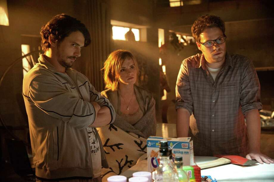 "From left, James Franco, Emma Watson and Seth Rogan star in Columbia Pictures' ""This Is The End,"" also starring Jonah Hill, Jay Baruchel, Danny McBride and Craig Robinson. (Suzanne Hanover/MCT) Photo: Suzanne Hanover, McClatchy-Tribune News Service / MCT"