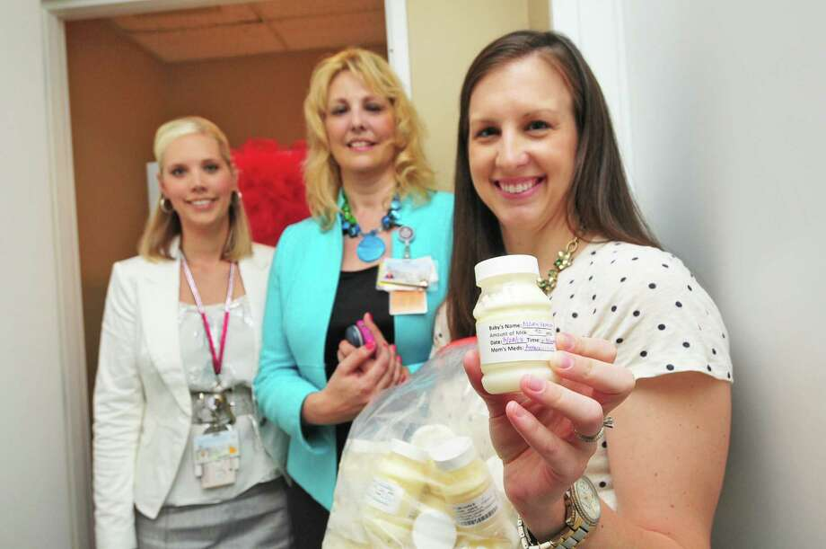 Lactation specialist Jocelyn Possehl, left, Women's Center director Renee Huon and Laura Verrett, with a bottle of her breast milk, celebrate the drop-off opening at the medical center. Photo: Â Tony Bullard 2013, Freelance Photographer / © Tony Bullard & the Houston Chronicle