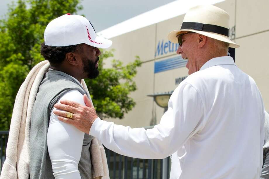 Texans safety Ed Reed, left, is greeted by Texans owner Bob McNair. Photo: Brett Coomer, Chronicle