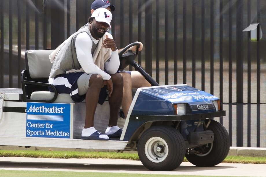 Texans safety Ed Reed, left, rides out to the practice field. Photo: Brett Coomer, Chronicle