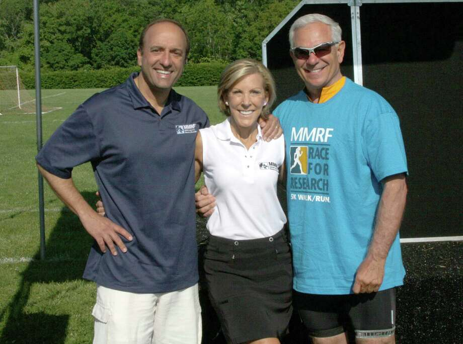 New Canaan residents Paul and Kathy Giusti of the Multiple Myeloma Research Foundation with baseball legend Bobby Valentine at the MMRF Race for Research: Tri-State 5K Walk/Run held June 9 in New Canaan. Photo: Contributed Photo