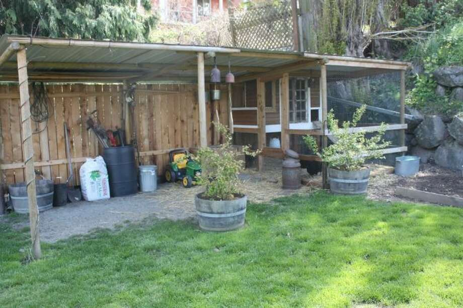 Back yard chicken coop and storage area of 3842 23rd Ave. S.W. The 2,360-square-foot Craftsman, built in 1914, has three bedrooms, one bathroom and a front porch on a 5,000-square-foot lot. It's listed for $449,000. Photo: Courtesy Of Candace Legg-Cadigan, Windermere Real Estate