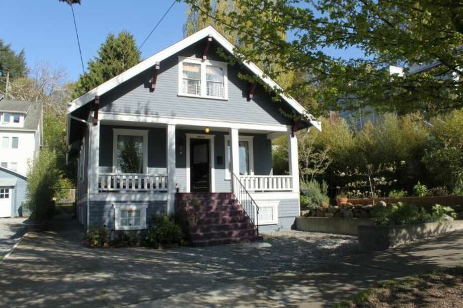Finally, here's 3842 23rd Ave. S.W. The 2,360-square-foot Craftsman, built in 1914, has three bedrooms, one bathroom, a front porch and a big backyard with raised garden beds and a chicken coop on a 5,000-square-foot lot. It's listed for $449,000. Photo: Courtesy Of Candace Legg-Cadigan, Windermere Real Estate