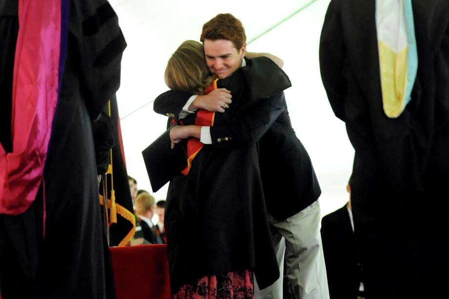 Graduate Thomas Hugh Carey Cassidy embraces his mother, Nancy Carey Cassidy, as she presents his diploma during commencement exercises on Tuesday, June 11, 2013, at The Albany Academy in Albany, N.Y. The graduate is the grandson of the late Gov. Hugh Carey. (Cindy Schultz / Times Union) Photo: Cindy Schultz / 00022758A