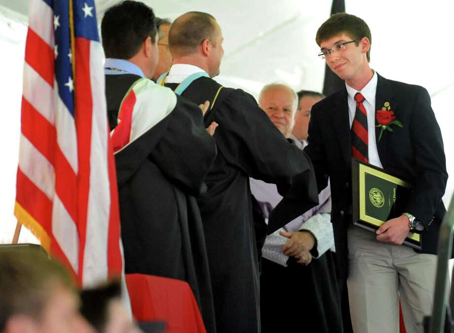 Valedictorian Gavin Piester, right, receives congratulations after delivering his address during commencement exercises on Tuesday, June 11, 2013, at The Albany Academy in Albany, N.Y. (Cindy Schultz / Times Union) Photo: Cindy Schultz / 00022758A