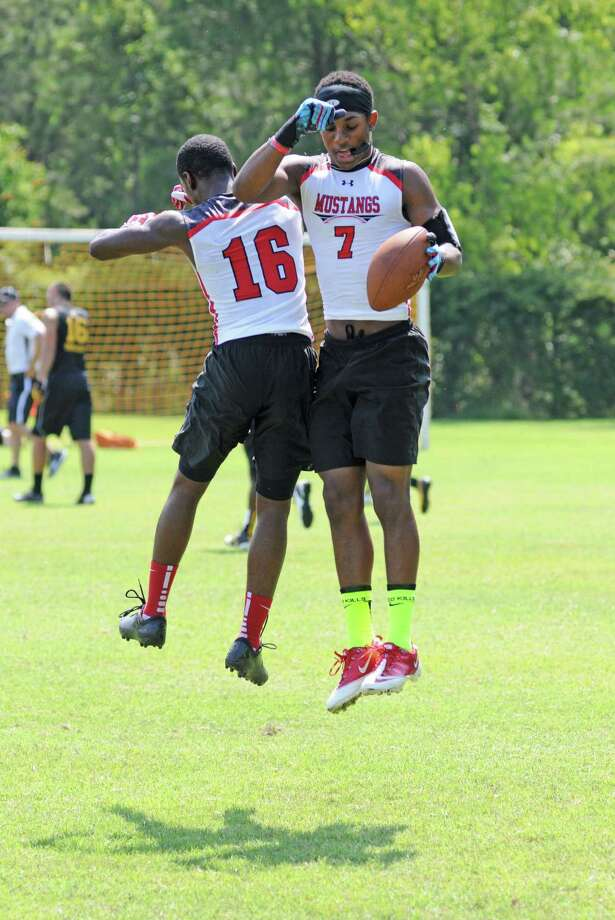 Westfield senior quarterback William Dedon, left photo, junior Johmarco Kizzie (16) and senior Courtland Greenwood (7) and the Mustangs earned a 7-on-7 summer football state berth by winning The Woodlands qualifying tournament in June. Photo: L. Scott Hainline / Freelance