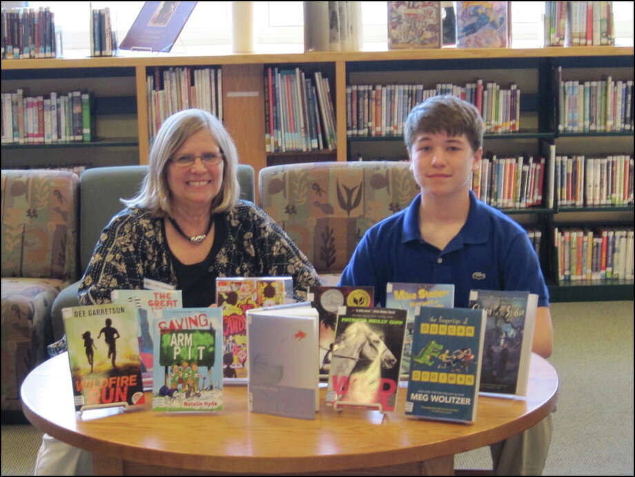 New Canaan Children's Librarian Cathy Townsend and James Hirai, a seventh-grade student at Saxe Middle School, served on Connecticutís 2014 Intermediate Nutmeg Selection Committee. Photo: Contributed