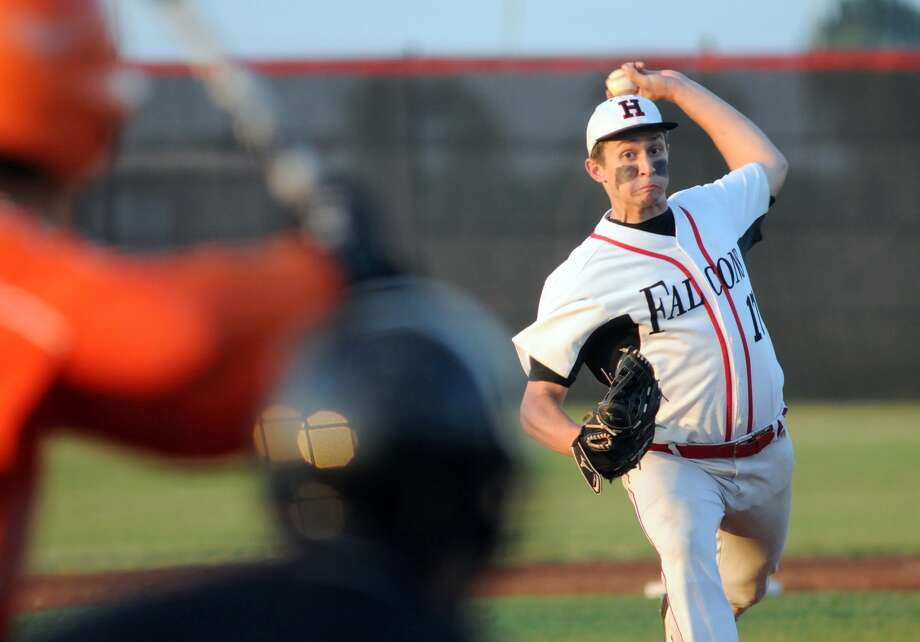 Huffman Hargrave pitcher Cody Carver capped his impressive career with the Falcons, leading the team to their sixth district title in eight years and a run to the regional semifinals. Photo: Jerry Baker, Freelance