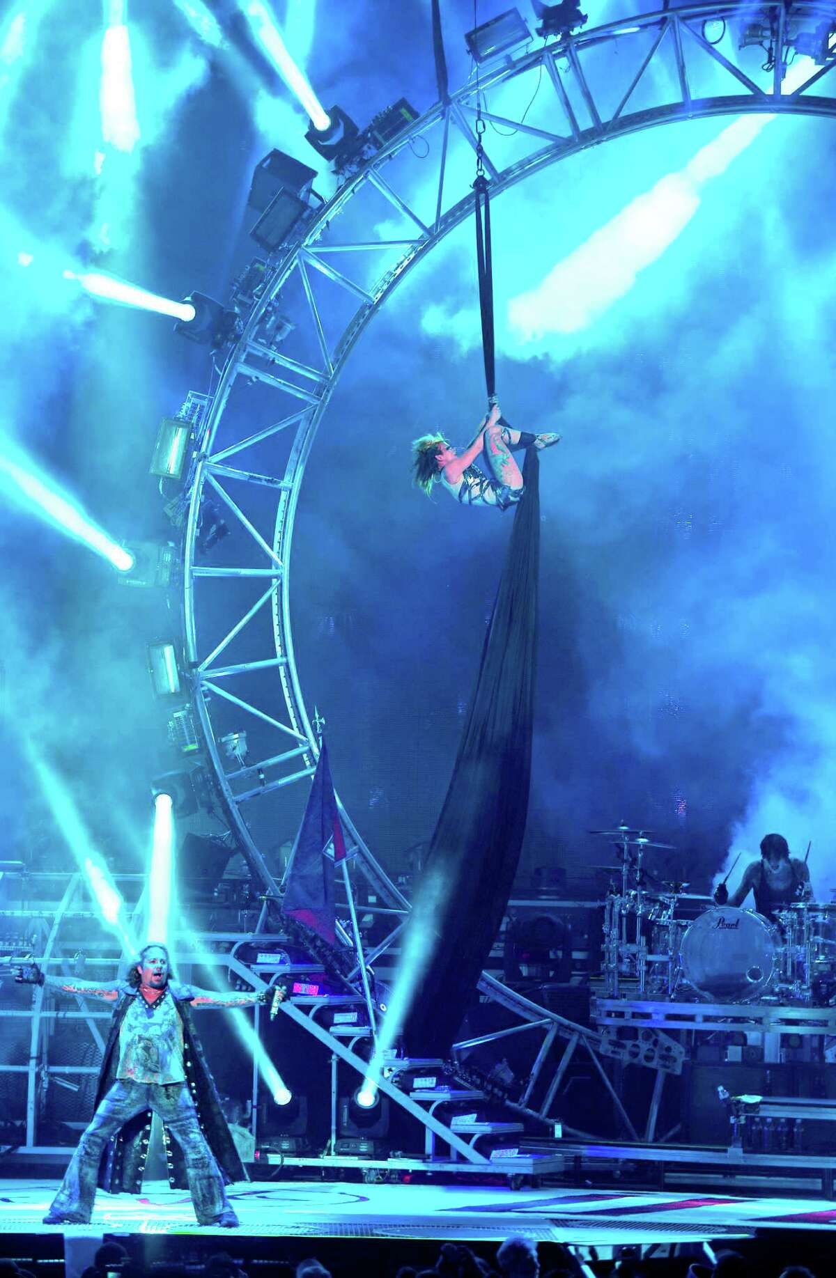 Vince Neil (left) and Tommy Lee (right) on the Cirque du Soleil-style set at the opening of their tour with Kiss July 20 in Bristow, Virginia.