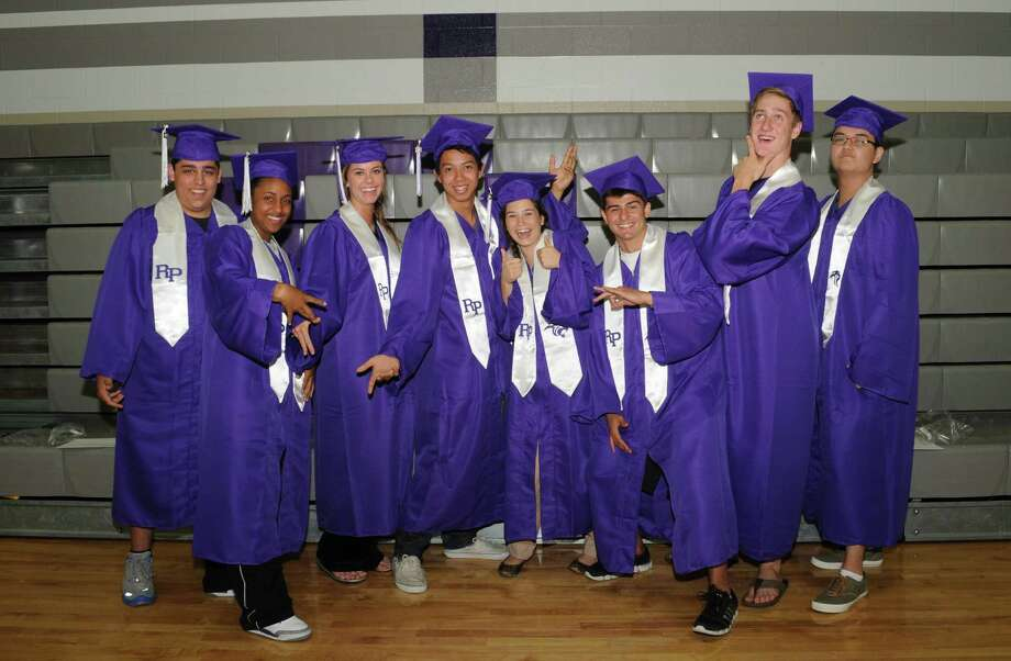 Trying on a cap and gown at practice are Ridge Point High School 2013 seniors, from left, Demitrious Abraham, Allyson Barker, Michaela MacMillam, Andrew Tran, salutatorian Alyson Miranda, Tommy Batchelor, valedictorian Duff Dean and David Hughes. Photo: George Wong / Freelance