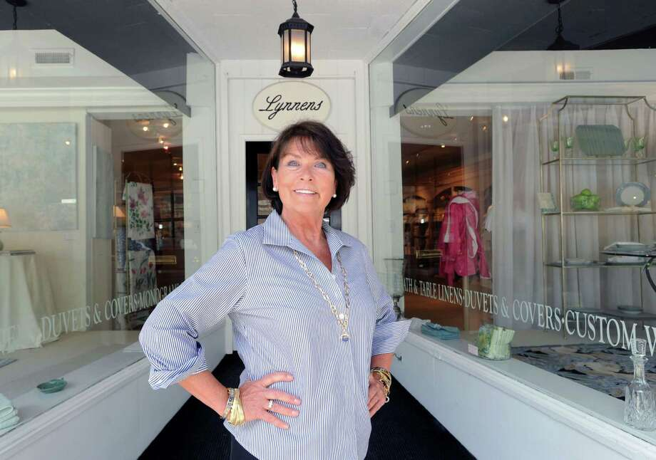 Lynne Jenkins, owner of Lynnens of Greenwich, a high-end luxury linen shop, in front of her store at 278 Greenwich Ave., Tuesday, June 11, 2013. Photo: Bob Luckey / Greenwich Time