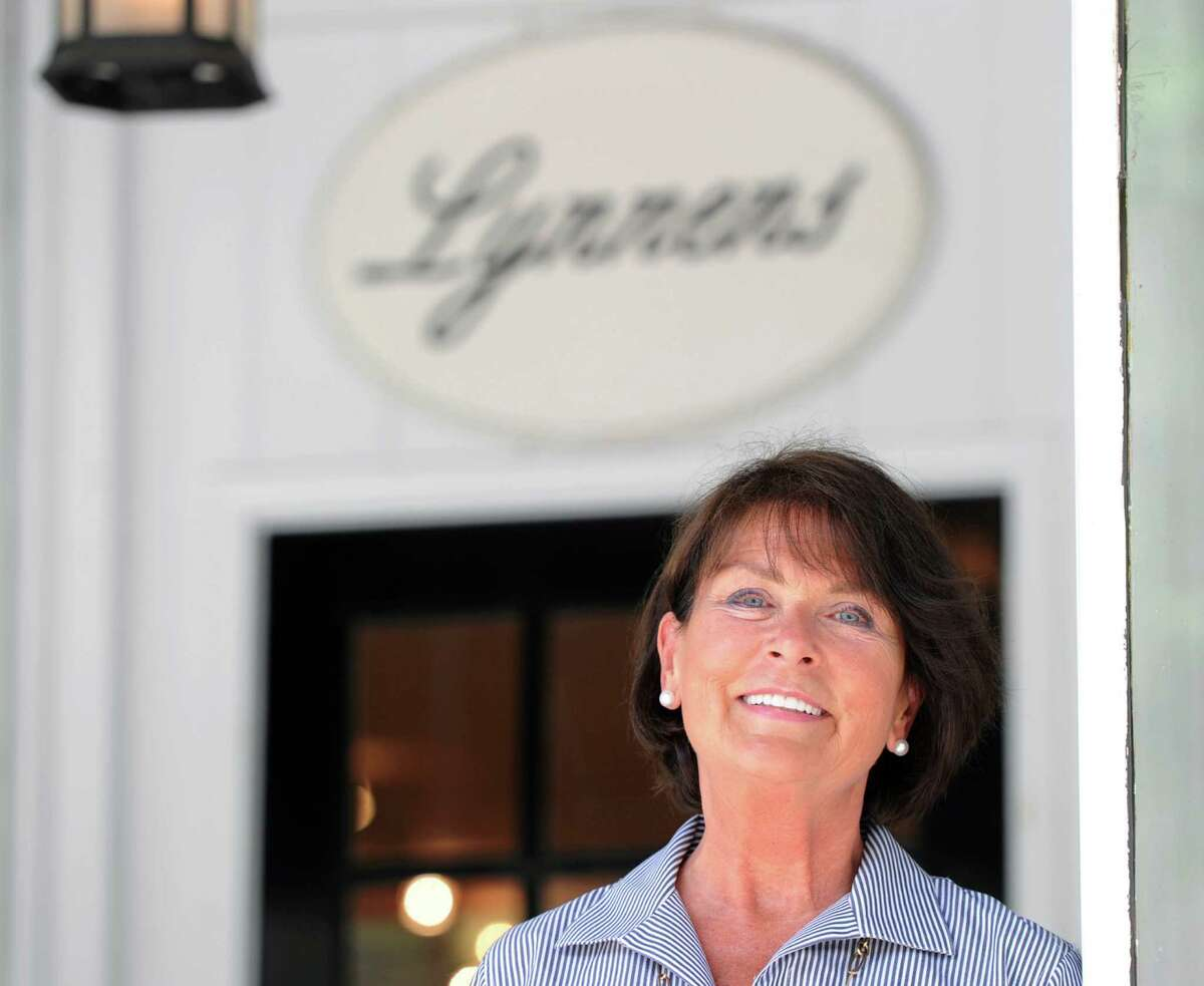 Lynne Jenkins, owner of Lynnens of Greenwich, a high-end luxury linen shop, in front of her store at 278 Greenwich Ave., Tuesday, June 11, 2013.
