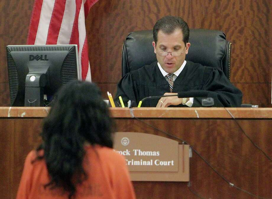 Ana Lilia Trujillo stands before Judge Brock Thomas in Thomas' 338th State District Court, Trujillo has reportedly told police she was trying protect herself has when she allegedly stabbed her boyfriend with a stiletto high heel at a high-rise condo, Trujillo is charged with murder in the stabbing death according to the Houston Police Department Tuesday, June 11, 2013, in Houston. Photo: James Nielsen, Houston Chronicle / © 2013  Houston Chronicle