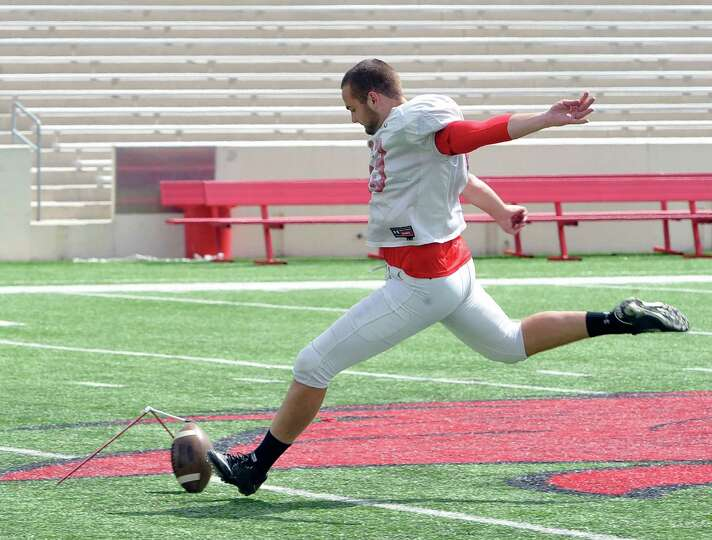 Lamar kicker #53, Alex Ball, gets in a few extra field goal kicks after the game had ended. On Satur
