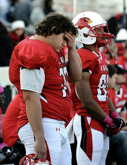 Lamar offensive lineman Brock Wempa hangs his head after another SHSU touchdown during the football