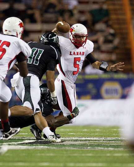 Lamar quarterback Ryan Mossakowski gets sacked by the Hawaiian defense during the second quarter of
