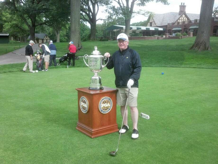 Our trusty golf columnist with the Wanamaker Trophy, presented to the PGA Championship winner.