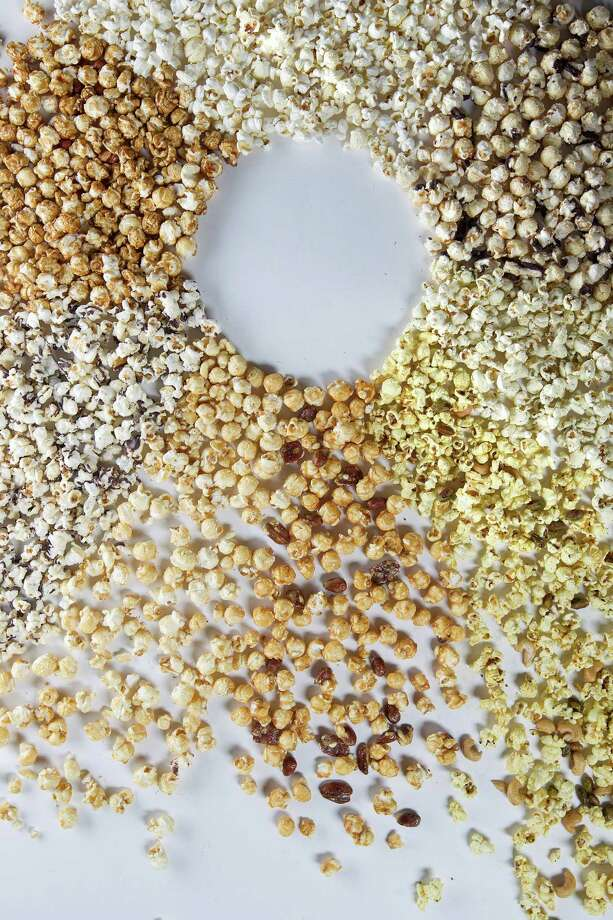 All types of popcorn including chocolate-topped, curry, pepper, and Cracker Jack to name a few Thursday, June 6, 2013, in Houston. ( Johnny Hanson / Houston Chronicle ) Photo: Johnny Hanson, Staff / © 2013  Houston Chronicle