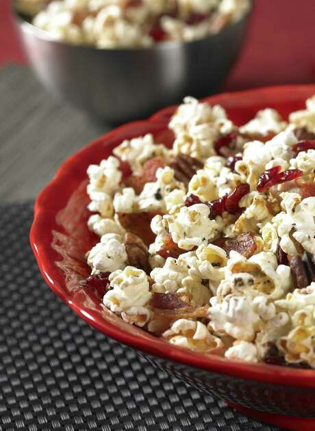 Maple Bacon Popcorn Mix is a recipe that includes thick-cut bacon, maple syrup, pecan halves and dried cranberries Photo: The Popcorn Board