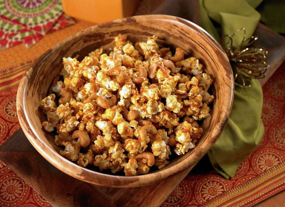 Coconut Curry Cashew Popcorn recipe includes flaked coconut, honey, cashews and curry powder. Photo: The Popcorn Board
