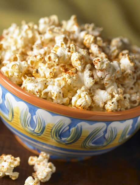 Cajun Corn flavored popcorn recipe includes paprika, onion powder, garlic powder and cayenne pepper. Photo: Quintet Publishing Limited