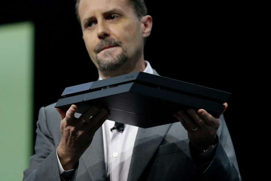 Sony Computer Entertainment president and CEO Andrew House introduces the new PlayStation 4 at the Sony PlayStation E3 media briefing in Los Angeles, Monday, June 10, 2013. Sony is giving gamers their first look at the PlayStation 4 and it's a rectangular black box, just like all the previous PlayStations. Photo: Jae C. Hong