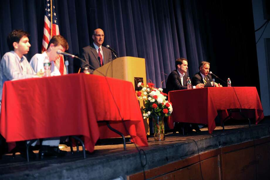 Nick Debany, Young Republicans, senior; Nick Abbott, Young Democrats, junior; Chris Winters, Headmaster; and  Rep. Jims Himes, D-Greenwich; and Fred Camillo, State Rep., in a discussion on gun control in the auditorium, at Greenwich High School, in Greenwich, Tuesday, June 6, 2013. Photo: Helen Neafsey / Greenwich Time