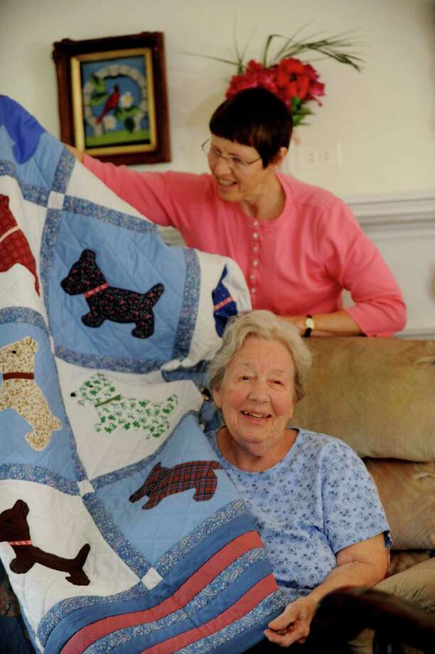 Elly Vance, holds one of the 50 quilts that her mother, Burnice Hubbard made, now she turns 100 this week in Greenwich, Monday, June 10, 2013. Photo: Helen Neafsey / Greenwich Time