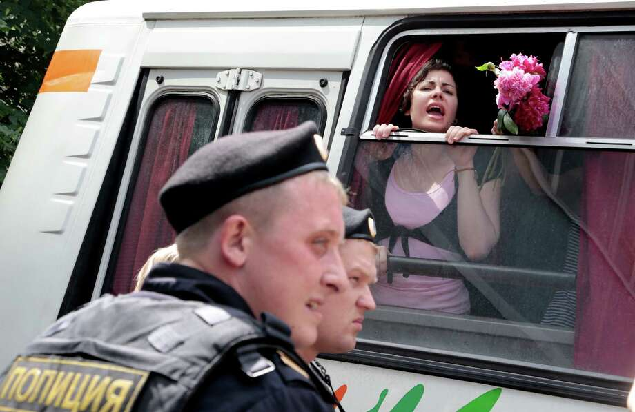 A gay rights activist shouts from a police bus Tuesday in Moscow after a bill stigmatizing gay people was passed by the State Duma, Russia's lower parliament. Photo: Ivan Sekretarev, STF / AP