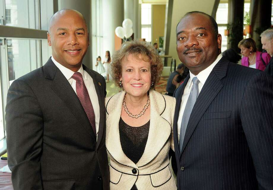 "From left: Kevin J. Roy, Regina Rogers and Everette ""Bo"" Alfred at the Chiildren's Defense Fund's Beat the Odds Luncheon at the Hilton Americas Hotel Tuesday June 04, 2013.(Dave Rossman photo) Photo: Dave Rossman, Freelance / © 2013 Dave Rossman"