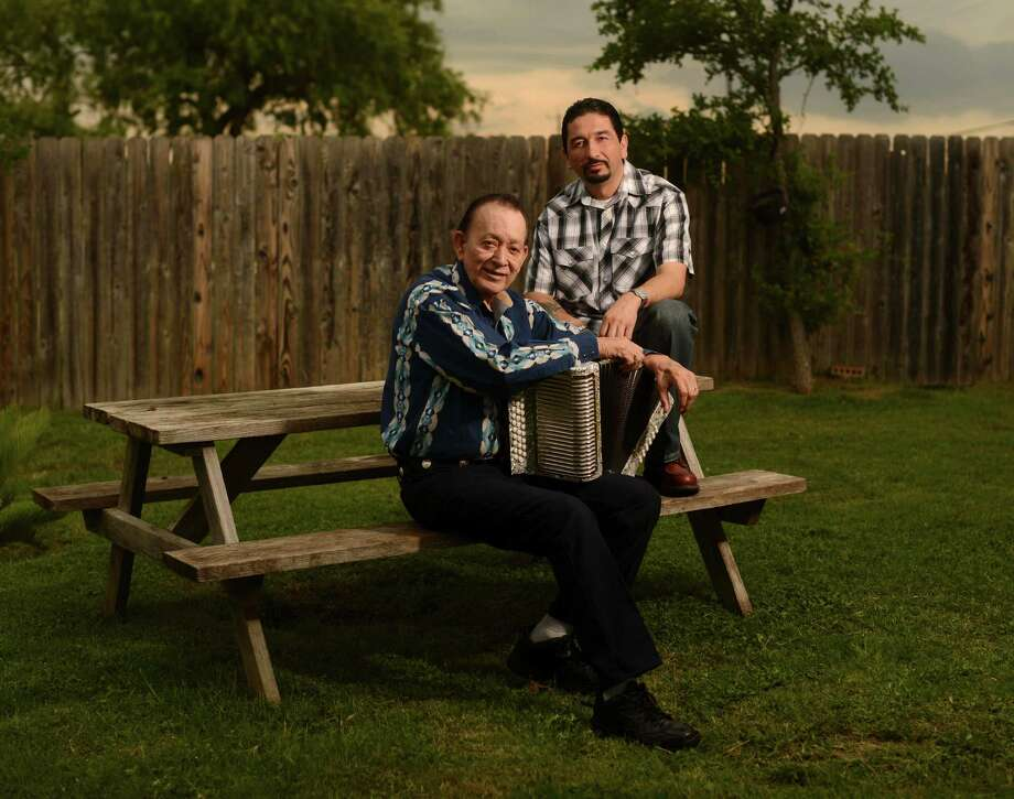 Tejano music legend Flaco Jimenez and his son Leonardo Jimenez III sit in the yard of their San Antonio home on Friday, June 7, 2013. Photo: Billy Calzada, San Antonio Express-News / San Antonio Express-News